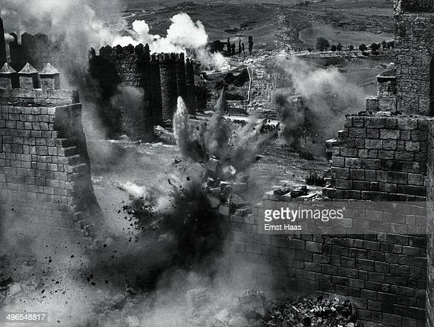 The wall of Avila is reconstructed and then blown up with explosives on the set of the film 'The Pride and the Passion' 1956