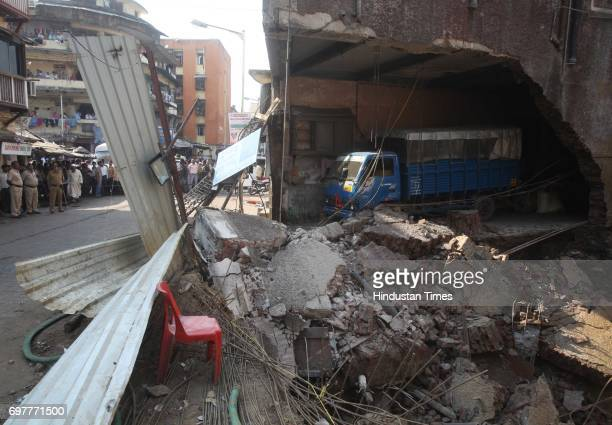 The wall of centuryold vacant building Yah Allah that came crashing down at Kamathipura on Monday afternoon No one was injured when the wall...