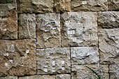 The wall of the large stone blocks, with a pattern. Background. Texture.