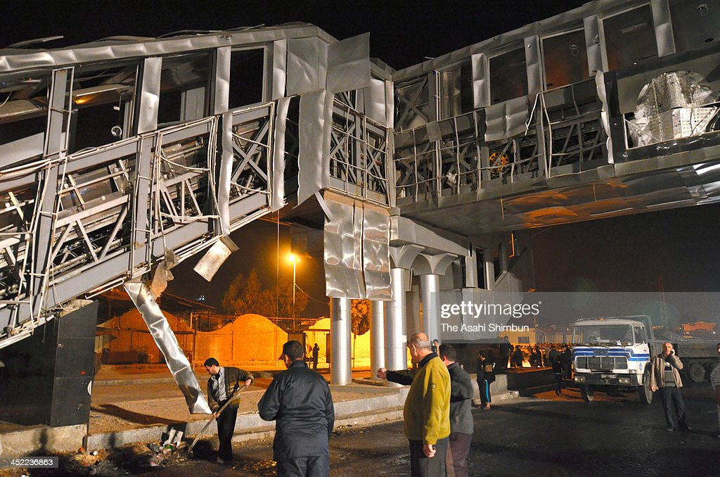 The wall of the stairs are blown off at a bus terminal, 7 kilometres west of Damascus city centre on November 26, 2013 in Damascus, Syria. Official Syrian Arab News Agency reported 15 people, including 2 children, were killed by the suicide bomb attack.
