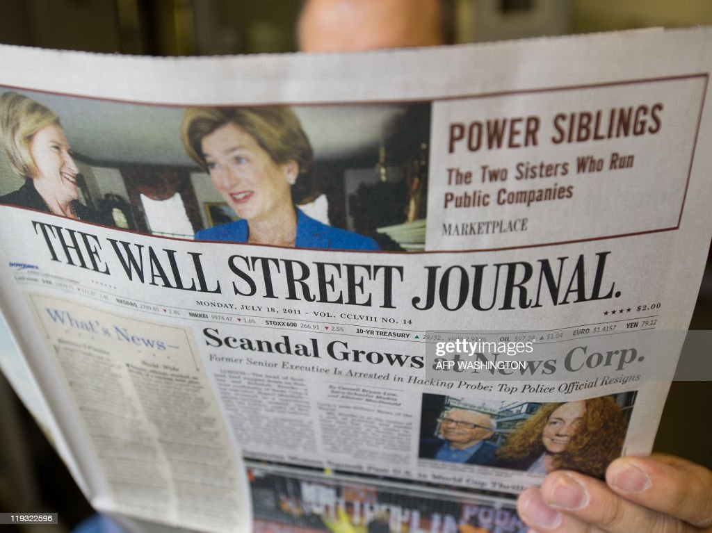 The Wall Street Journal is viewed on July 18, 2011 in Washington,DC. The News Corp.-owned Wall Street Journal blasted critics Monday for double standards and insisted that the phone-tapping scandal in Britain should not tarnish all of Rupert Murdoch's media empire. The powerful Journal, the flagship of Murdoch's US print operations, also warned that pressure to investigate News Corp. under US laws against bribing foreign officials could backfire on the entire media. 'Do our media brethren really want to invite Congress and prosecutors to regulate how journalists gather the news?' the country's leading financial newspaper asked in an editorial. The newspaper, owned by Dow Jones & Co, taken over by News Corp. four years ago, accused politicians and competitors of 'using the phone-hacking years ago at a British corner of News Corp. to assail the Journal, and perhaps injure press freedom as well.' AFP Photo/Paul J. Richards
