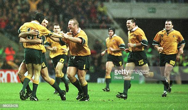 The Wallabies celebrate the drop goal of Stephen Larkham against the Springboks in the semi final of the Rugby World Cup at Twickenham on Saturday...