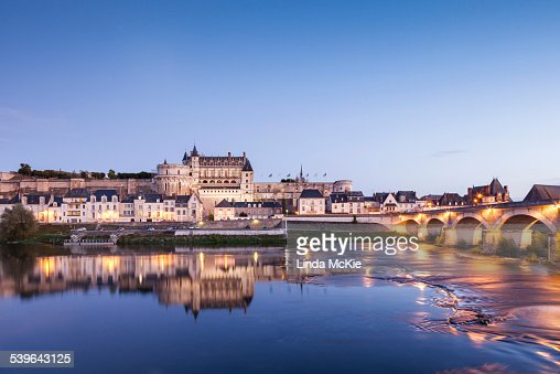 The walled town and Chateau of Amboise reflected in the River Loire in the evening, Amboise, Centre, France