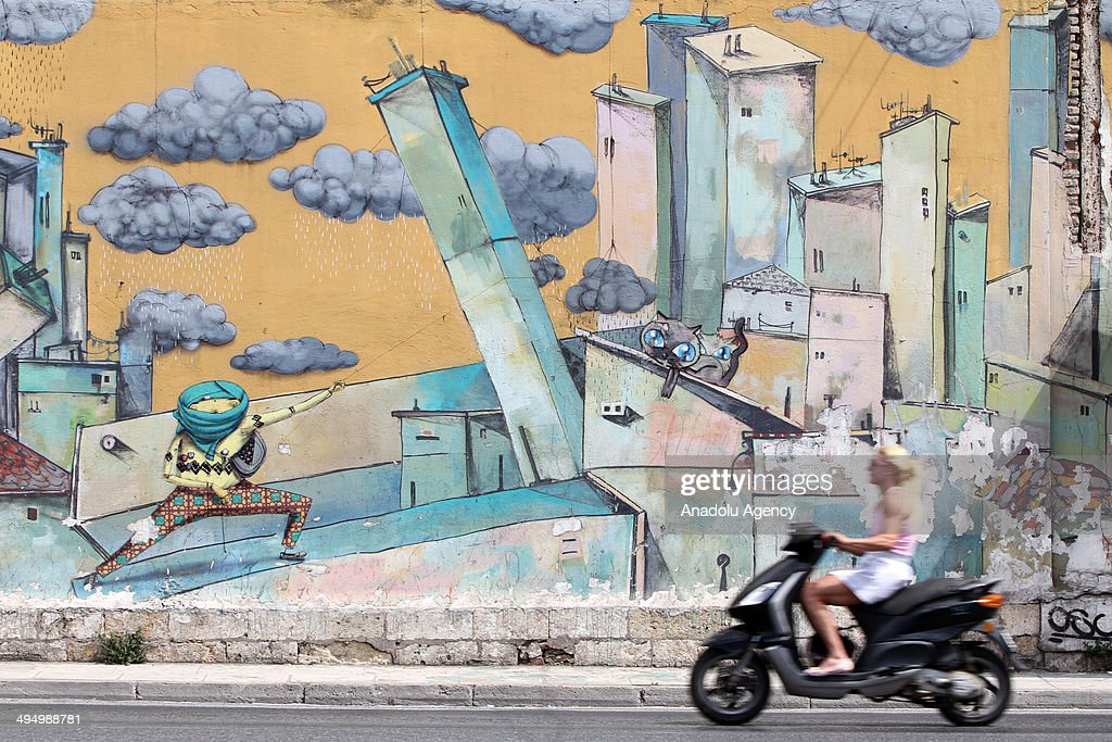 The walls are being decorated with kinds of graffiti designs in Athens, Greece on June 1, 2014. The walls reflect Greek people's ideas over unrests in the country and attract attention by many people.