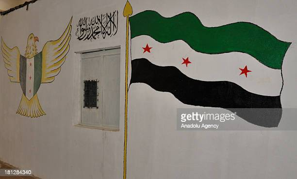 The walls of the prison in Aleppo with Syrian opposition flag and logo on August 21 2013 in AleppoSyria The Aleppo prison in the Al Ray building...