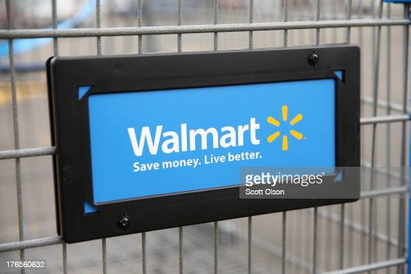 The Walmart logo is displayed on a shopping cart at a Walmart store on August 15 2013 in Chicago Illinois Walmart the world's largest retailer...