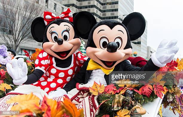 The Walt Disney Characters Minnie Mouse and Mickey Mouse attend the 95th Annual 6abc Dunkin' Donuts Thanksgiving Day Parade on November 27 2014 in...