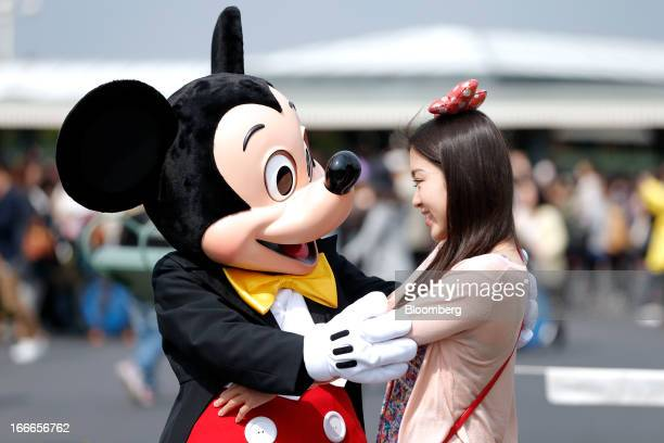The Walt Disney Co character Mickey Mouse left greets a visitor at Tokyo Disneyland operated by Oriental Land Co in Urayasu City Chiba Prefecture...