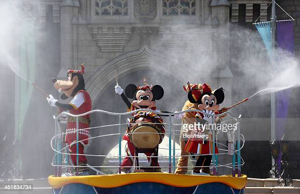 The Walt Disney Co characters Mickey Mouse center and Minnie Mouse right perform in front of the Cinderella Castle during an event named 'Disney...