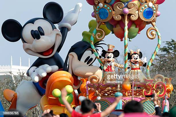The Walt Disney Co characters Mickey Mouse second from right and Minnie Mouse right perform during a new parade to commemorate the 30th anniversary...