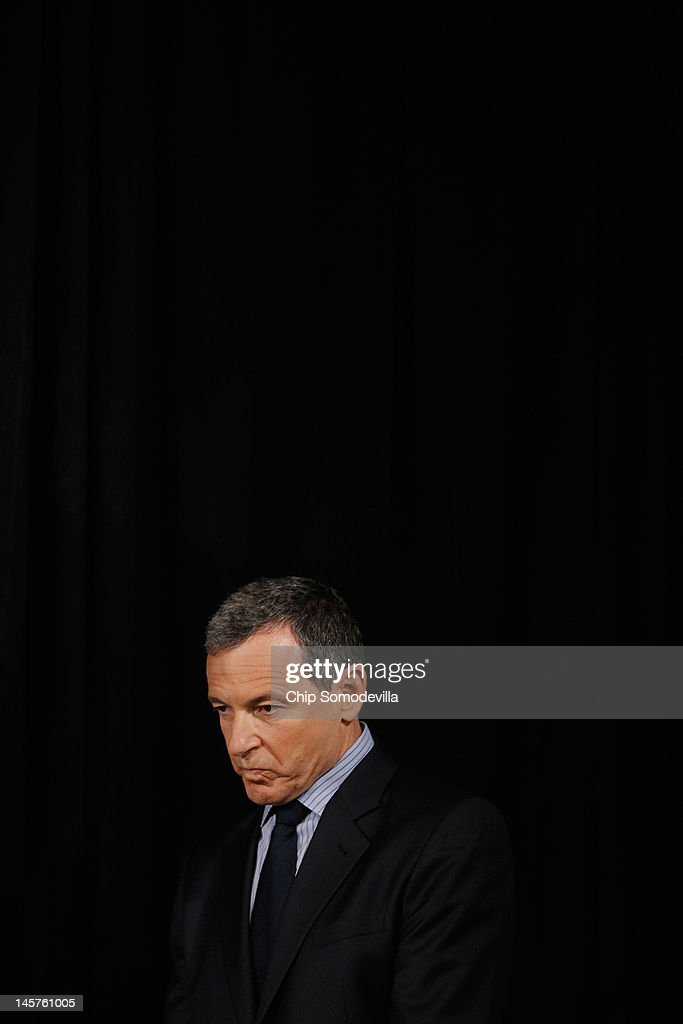 The Walt Disney Company Chairman and CEO Robert Iger listens to remarks by U.S. first lady Michelle Obama during an event introducing Disney's new 'Magic of Healthy Living' program at the Newseum June 5, 2012 in Washington, DC. As part of the new healthy eating initiative, all products advertised on Disney's child-focused television channels, radio stations and Web sites must adhear to a new set of strict nutritional standards. Addionally, Disney-licensed products that meet criteria for limited calories, saturated fat, sodium and sugar can display a logo - Mickey Mouse ears and a check mark - on their packaging.