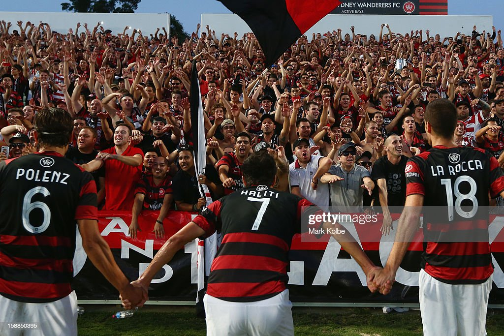 The Wanderers celebrate with the crowd after victory in the round 14 A-League match between the Western Sydney Wanderers and the Melbourne Victory at Parramatta Stadium on January 1, 2013 in Sydney, Australia.