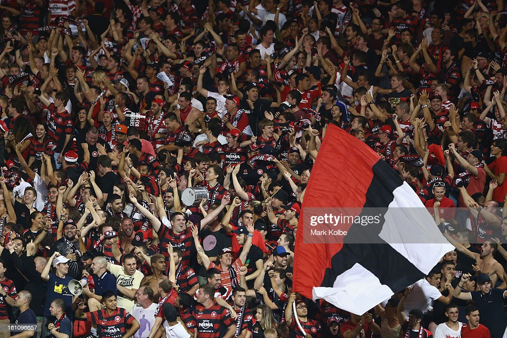The Wanderers suporters in the crowd celebrate a goal during the round 20 A-League match between the Western Sydney Wanderers and the Newcastle Jets at Campbelltown Sports Stadium on February 9, 2013 in Sydney, Australia.
