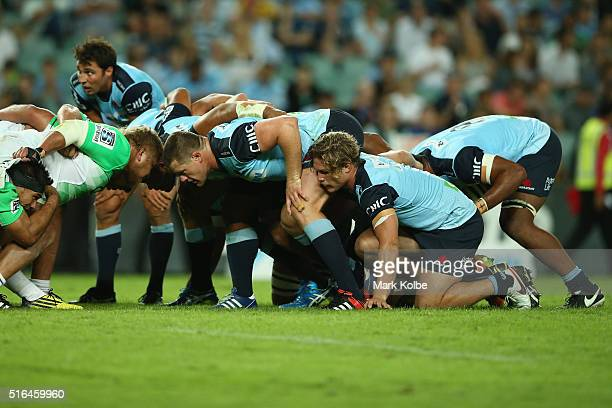 The Waratahs scrum packs down during the Super Rugby match between the New South Wales Waratahs and the Highlanders at Allianz Stadium on March 18...