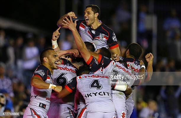 The Warriors celebrate the try of Shaun Johnson to win the game during the round nine NRL match between the Sharks and the Warriors at Remondis...