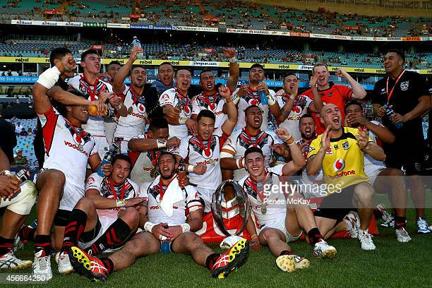 The Warriors celebrate winning the 2014 Under 20's Holden Cup Grand Final match between the Brisbane Broncos and the New Zealand Warriors at ANZ...