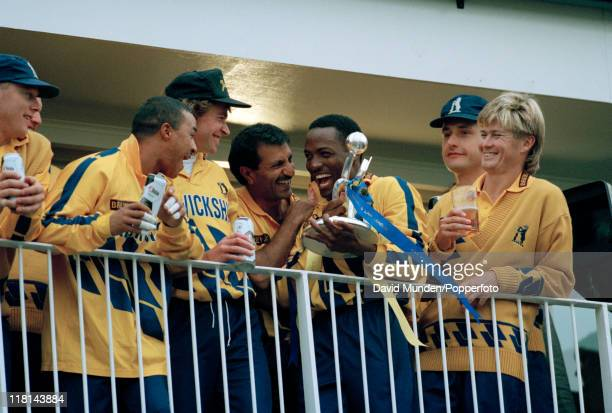 The Warwickshire team celebrate with the trophy after securing the Axa Equity and Law league title after defeating Gloucestershire by 46 runs at the...