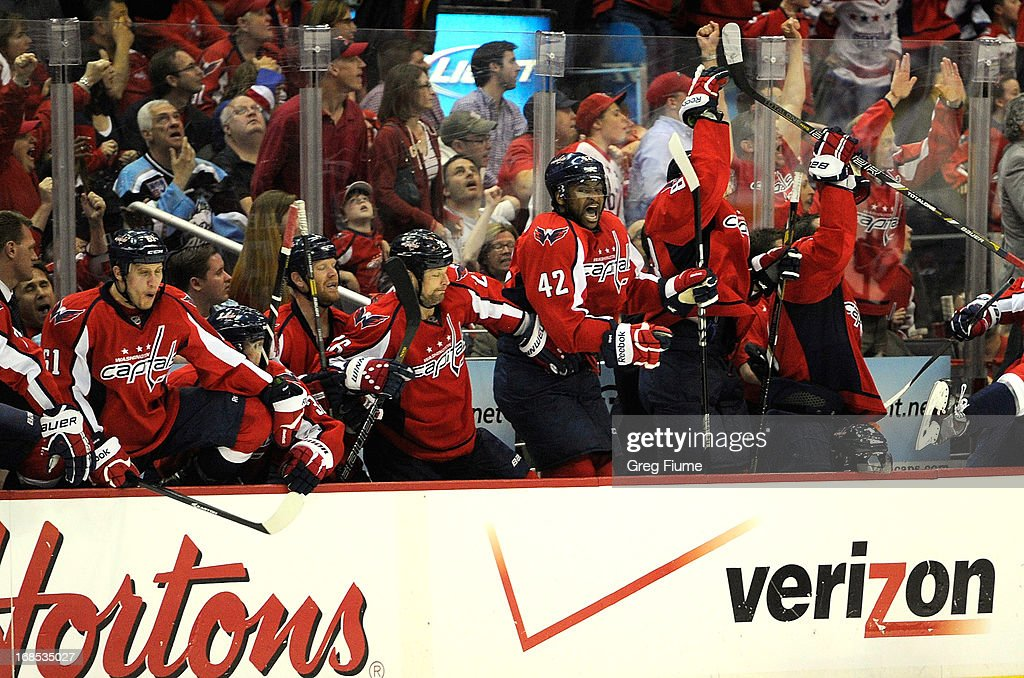 The Washington Capitals bench celebrates after Mike Ribeiro #9 (not pictured) scored the game winning goal in overtime against the New York Rangers in Game Five of the Eastern Conference Quarterfinals during the 2013 NHL Stanley Cup Playoffs at the Verizon Center on May 10, 2013 in Washington, DC. Washington won 2-1.