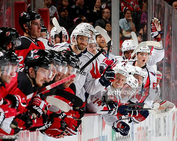 The Washington Capitals bench celebrates after teammate TJ Oshie scores in the shootout against the New Jersey Devils on February 6 2016 at...