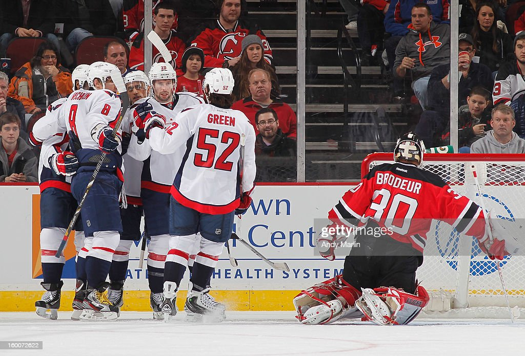 The Washington Capitals celebrate a goal as Martin Brodeur #30 of the New Jersey Devils looks away during the game at the Prudential Center on January 25, 2013 in Newark, New Jersey.