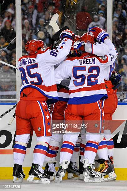 The Washington Capitals celebrate a goal by teammate Mike Knuble during the second period of the game against the Pittsburgh Penguins at the 2011 NHL...