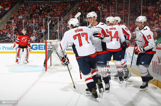 The Washington Capitals celebrate a goal by TJ Oshie against Cory Schneider of the New Jersey Devils at 1449 of the first period at the Prudential...