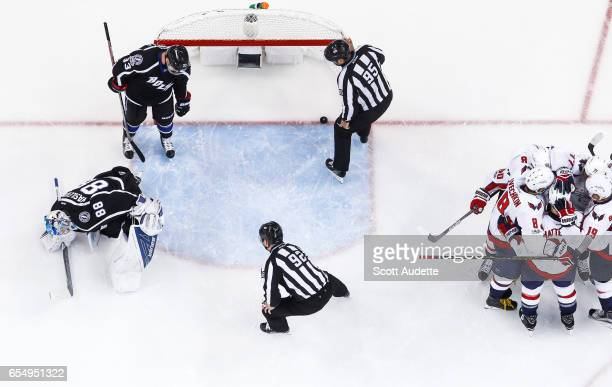 The Washington Capitals celebrate a goal by TJ Oshie against goalie Andrei Vasilevskiy and Greg McKegg of the Tampa Bay Lightning during the first...