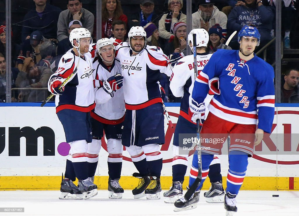 The Washington Capitals celebrate a second period goal by <a gi-track='captionPersonalityLinkClicked' href=/galleries/search?phrase=T.J.+Oshie&family=editorial&specificpeople=700383 ng-click='$event.stopPropagation()'>T.J. Oshie</a> #77 (2nd from left) against the New York Rangers at Madison Square Garden on December 20, 2015 in New York City. Joining Oshie are (l-r <a gi-track='captionPersonalityLinkClicked' href=/galleries/search?phrase=Karl+Alzner&family=editorial&specificpeople=3938829 ng-click='$event.stopPropagation()'>Karl Alzner</a> #27, Oshie, Alex Ovechkin #8 and Nicklas Backstrom #19.