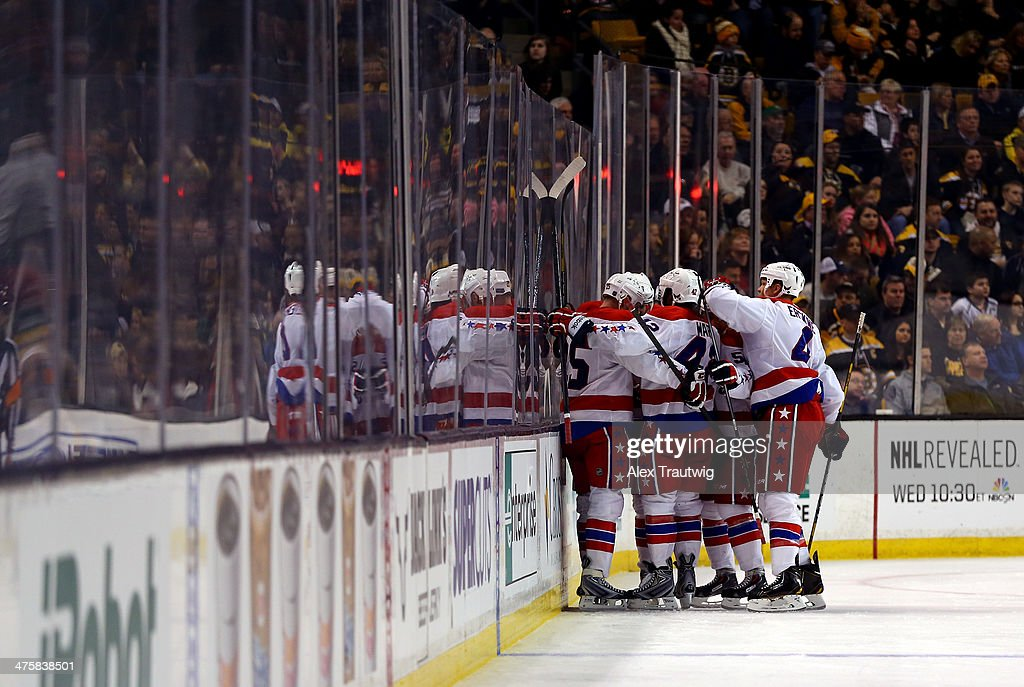 The Washington Capitals celebrate a third period goal by <a gi-track='captionPersonalityLinkClicked' href=/galleries/search?phrase=Eric+Fehr&family=editorial&specificpeople=566939 ng-click='$event.stopPropagation()'>Eric Fehr</a> #16 of the Washington Capitals against the Boston Bruins during a game at the TD Garden on March 1, 2014 in Boston, Massachusetts. The Washington Capitals defeated the Boston Bruins 4-2.