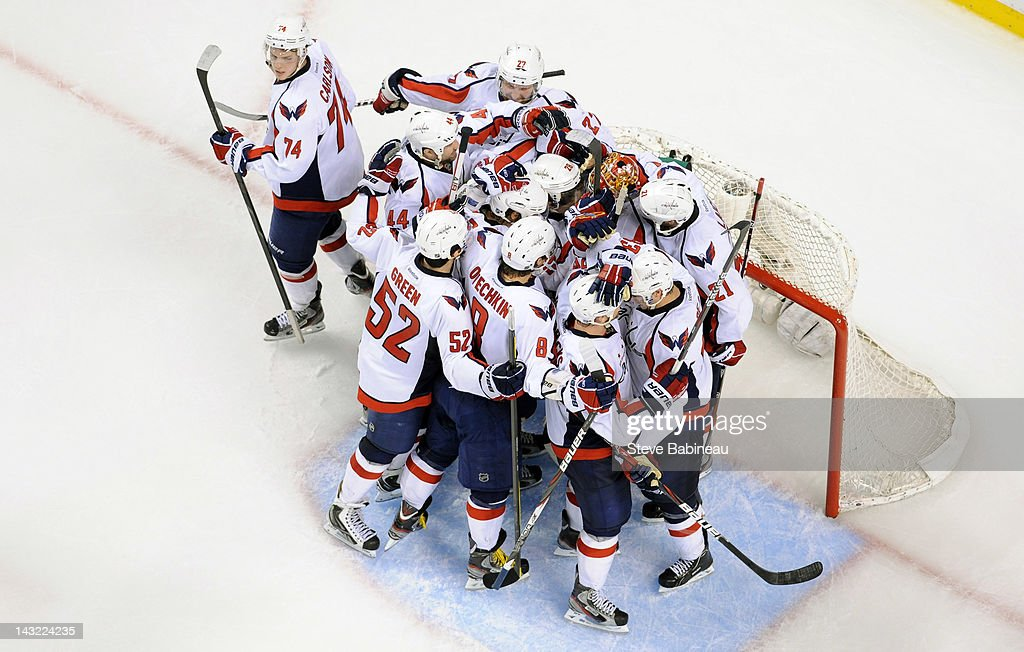 The Washington Capitals celebrate a win against the Boston Bruins in Game Five of the Eastern Conference Quarterfinals during the 2012 NHL Stanley Cup Playoffs at TD Garden on April 21, 2012 in Boston, Massachusetts.