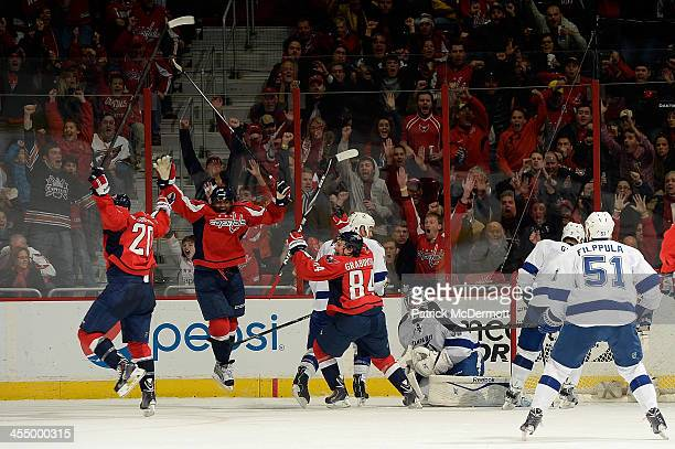 The Washington Capitals celebrate after Alex Ovechkin after scored a goal in the third period during an NHL game against the Tampa Bay Lightning at...