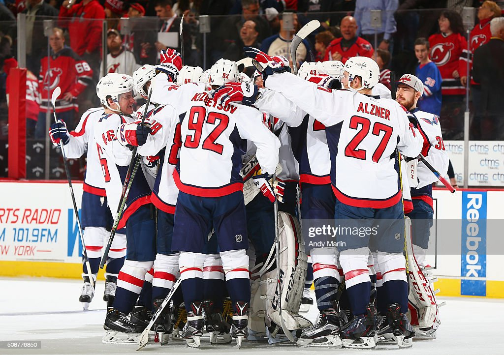 The Washington Capitals celebrate after defeating the New Jersey Devils in a shootout at the Prudential Center on February 6, 2016 in Newark, New Jersey. The Capitals defeated the Devils 3-2.
