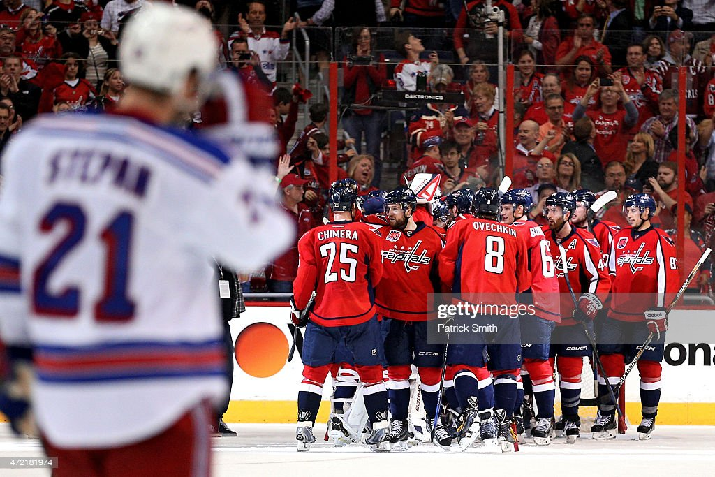 The Washington Capitals celebrate after defeating the New York Rangers in Game Three of the Eastern Conference Semifinals during the 2015 NHL Stanley...