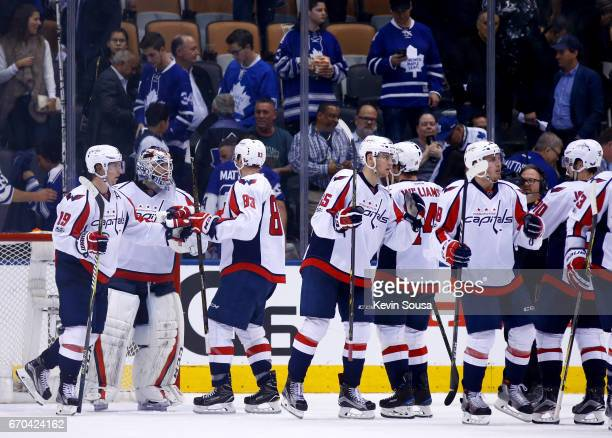 The Washington Capitals celebrate after defeating the Toronto Maple Leafs in Game Four of the Eastern Conference First Round during the 2017 NHL...