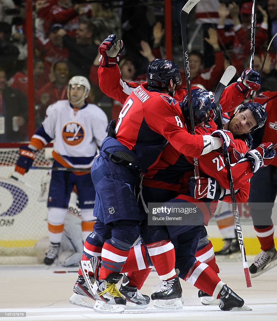 The Washington Capitals celebrate the game tying goal against the New York Islanders at 19:34 of the third period at the Verizon Center on February 28, 2012 in Washington, DC. The Capitals defeated the Islanders 3-2 in overtime.