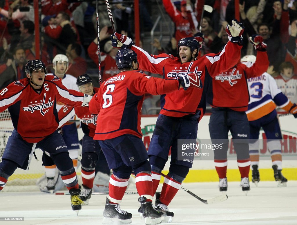 The Washington Capitals celebrate the game tying goal by <a gi-track='captionPersonalityLinkClicked' href=/galleries/search?phrase=Troy+Brouwer&family=editorial&specificpeople=4155305 ng-click='$event.stopPropagation()'>Troy Brouwer</a> #20 (R) against the New York Islanders at 19:34 of the third period at the Verizon Center on February 28, 2012 in Washington, DC. The Capitals defeated the Islanders 3-2 in overtime.