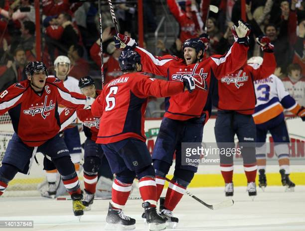 The Washington Capitals celebrate the game tying goal by Troy Brouwer against the New York Islanders at 1934 of the third period at the Verizon...