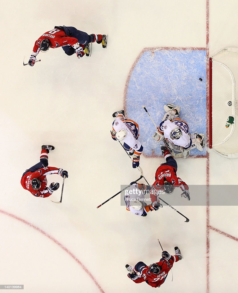 The Washington Capitals celebrate the game tying goal by <a gi-track='captionPersonalityLinkClicked' href=/galleries/search?phrase=Troy+Brouwer&family=editorial&specificpeople=4155305 ng-click='$event.stopPropagation()'>Troy Brouwer</a> #20 against the New York Islanders at 19:34 of the third period at the Verizon Center on February 28, 2012 in Washington, DC. The Capitals defeated the Islanders 3-2 in overtime.