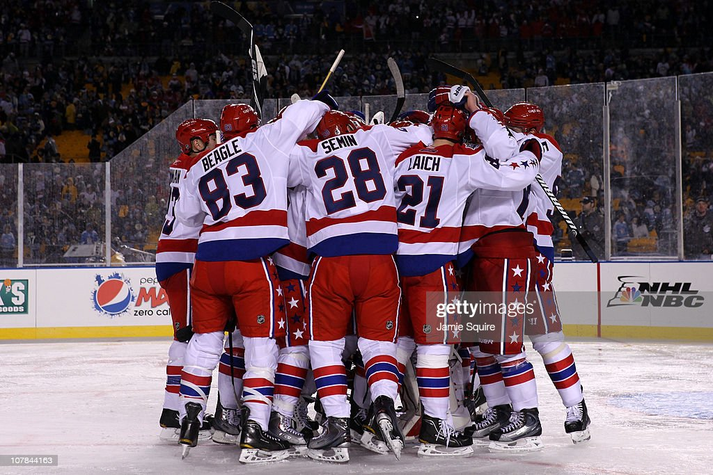 The Washington Capitals celebrate their 31 victory over the Pittsburgh Penguins during the 2011 NHL Bridgestone Winter Classic at Heinz Field on...