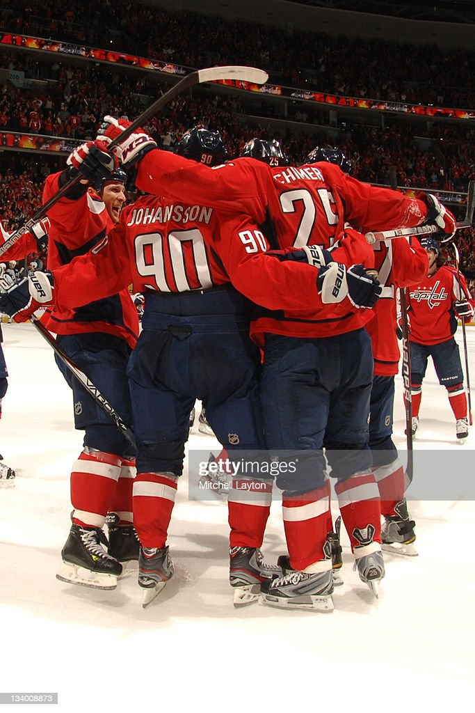 The Washington Capitals celebrate their win of a NHL hockey game against the Winnipeg Jets on November 23, 2011 at the Verizon Center in Washington, DC.