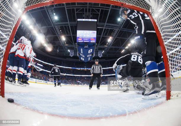 The Washington Capitals celebrates a goal against Greg McKegg and goalie Andrei Vasilevskiy of the Tampa Bay Lightning during the first period at...