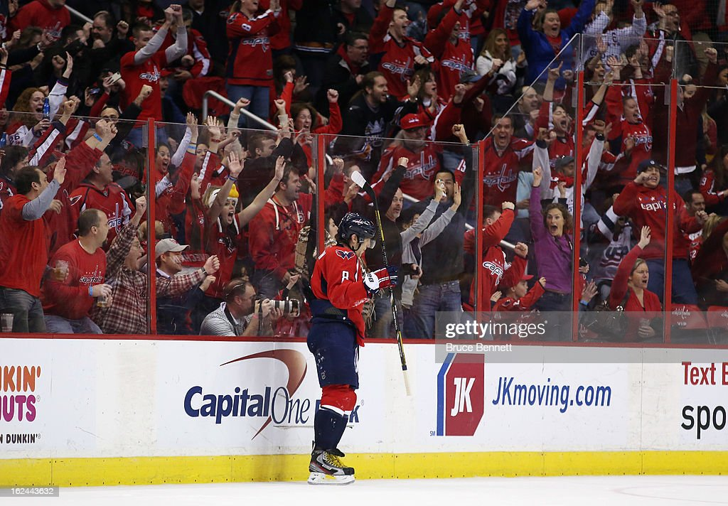 The Washington Capitals fans celebrate a goal by <a gi-track='captionPersonalityLinkClicked' href=/galleries/search?phrase=Troy+Brouwer&family=editorial&specificpeople=4155305 ng-click='$event.stopPropagation()'>Troy Brouwer</a> #20 (not shown) on an assist from Alex Ovechkin #8 at the Verizon Center on February 23, 2013 in Washington, DC. The Capitals defeated the Devils 5-1.