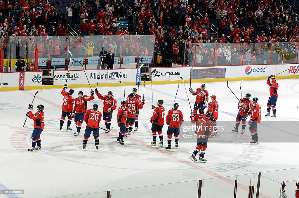 The Washington Capitals salute the crowd after a 5-0 victory against the Florida Panthers at the Verizon Center on February 9, 2013 in Washington, DC.