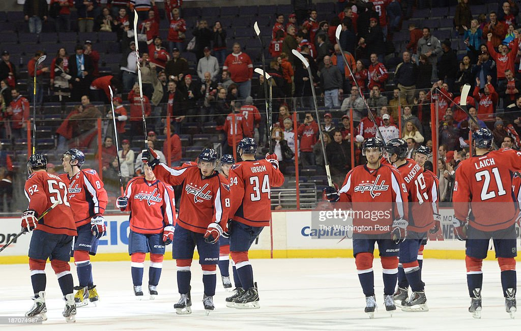 The Washington Capitals salute their fans following their 6-2 win over the New York Islanders on November 5, 2013 in Washington, DC.