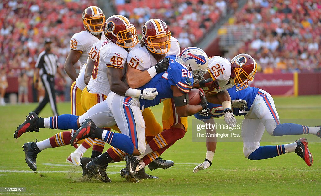 The Washington defense stops Buffalo Bills running back Tashard Choice (20) on a four yard run in the fourth quarter during a preseason game between the Buffalo Bills and the Washington Redskins at FedEx Field on August 24, 2013 in Landover, Md. Washington beat Buffalo 30-7.