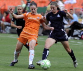 The Washington Freedom's Jill Gilbeau and Sky Blue FC's Collette McCallum battle for the ball during second half action in a Women's Professional...