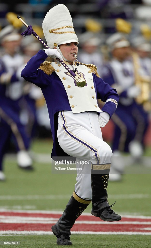 The Washington Huskies marching band leader performs on the field prior to the start of the Apple Cup game between the Washington Huskies and the Washington State Cougars at Martin Stadium on November 23, 2012 in Pullman, Washington.