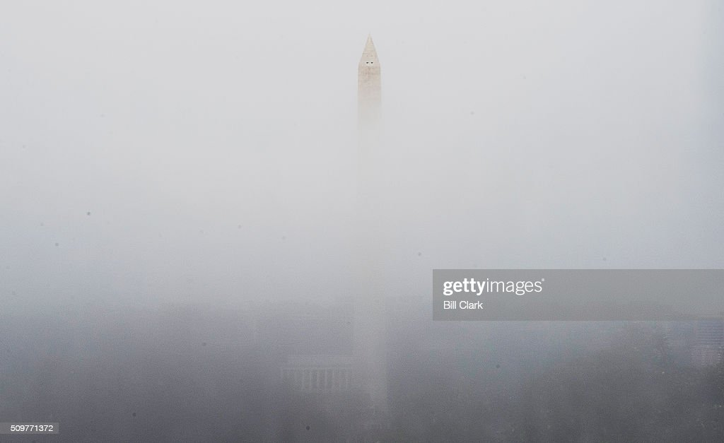 The Washington Monument and Lincoln Memorial are seen through condensation formed on the windows of the U.S. Capitol on Friday, Feb. 12, 2016.