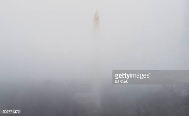 The Washington Monument and Lincoln Memorial are seen through condensation formed on the windows of the US Capitol on Friday Feb 12 2016