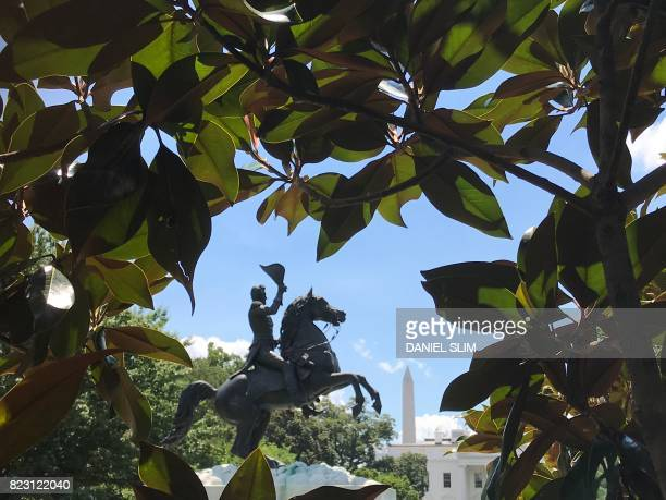 The Washington Monument and the White House are seen in the far behind a statue of Andrew Jackson in Lafayette Square in Washington DC July 25 2017...